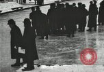 Image of Ice skating races outdoors on a flooded stadium ice rink during winter United States USA, 1900, second 14 stock footage video 65675063386