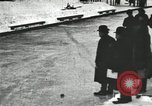 Image of Ice skating races outdoors on a flooded stadium ice rink during winter United States USA, 1900, second 19 stock footage video 65675063386