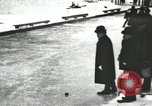 Image of Ice skating races outdoors on a flooded stadium ice rink during winter United States USA, 1900, second 20 stock footage video 65675063386