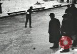 Image of Ice skating races outdoors on a flooded stadium ice rink during winter United States USA, 1900, second 21 stock footage video 65675063386