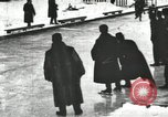Image of Ice skating races outdoors on a flooded stadium ice rink during winter United States USA, 1900, second 23 stock footage video 65675063386