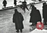 Image of Ice skating races outdoors on a flooded stadium ice rink during winter United States USA, 1900, second 24 stock footage video 65675063386