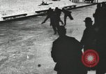 Image of Ice skating races outdoors on a flooded stadium ice rink during winter United States USA, 1900, second 30 stock footage video 65675063386