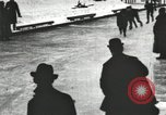 Image of Ice skating races outdoors on a flooded stadium ice rink during winter United States USA, 1900, second 33 stock footage video 65675063386