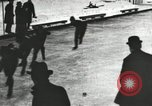 Image of Ice skating races outdoors on a flooded stadium ice rink during winter United States USA, 1900, second 34 stock footage video 65675063386