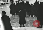 Image of Ice skating races outdoors on a flooded stadium ice rink during winter United States USA, 1900, second 35 stock footage video 65675063386