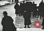 Image of Ice skating races outdoors on a flooded stadium ice rink during winter United States USA, 1900, second 36 stock footage video 65675063386