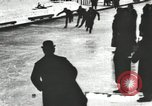 Image of Ice skating races outdoors on a flooded stadium ice rink during winter United States USA, 1900, second 40 stock footage video 65675063386