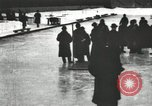 Image of Ice skating races outdoors on a flooded stadium ice rink during winter United States USA, 1900, second 42 stock footage video 65675063386