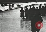 Image of Ice skating races outdoors on a flooded stadium ice rink during winter United States USA, 1900, second 43 stock footage video 65675063386