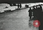 Image of Ice skating races outdoors on a flooded stadium ice rink during winter United States USA, 1900, second 44 stock footage video 65675063386