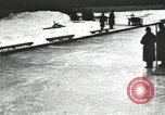 Image of Ice skating races outdoors on a flooded stadium ice rink during winter United States USA, 1900, second 45 stock footage video 65675063386