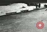 Image of Ice skating races outdoors on a flooded stadium ice rink during winter United States USA, 1900, second 46 stock footage video 65675063386