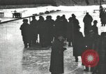 Image of Ice skating races outdoors on a flooded stadium ice rink during winter United States USA, 1900, second 48 stock footage video 65675063386