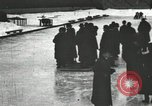 Image of Ice skating races outdoors on a flooded stadium ice rink during winter United States USA, 1900, second 49 stock footage video 65675063386