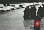 Image of Ice skating races outdoors on a flooded stadium ice rink during winter United States USA, 1900, second 50 stock footage video 65675063386