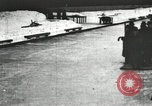 Image of Ice skating races outdoors on a flooded stadium ice rink during winter United States USA, 1900, second 52 stock footage video 65675063386