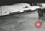 Image of Ice skating races outdoors on a flooded stadium ice rink during winter United States USA, 1900, second 54 stock footage video 65675063386