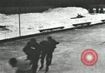 Image of Ice skating races outdoors on a flooded stadium ice rink during winter United States USA, 1900, second 55 stock footage video 65675063386