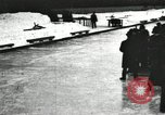 Image of Ice skating races outdoors on a flooded stadium ice rink during winter United States USA, 1900, second 56 stock footage video 65675063386