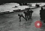 Image of Ice skating races outdoors on a flooded stadium ice rink during winter United States USA, 1900, second 58 stock footage video 65675063386