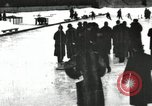 Image of Ice skating races outdoors on a flooded stadium ice rink during winter United States USA, 1900, second 59 stock footage video 65675063386