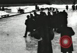 Image of Ice skating races outdoors on a flooded stadium ice rink during winter United States USA, 1900, second 60 stock footage video 65675063386