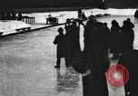 Image of Ice skating races outdoors on a flooded stadium ice rink during winter United States USA, 1900, second 61 stock footage video 65675063386