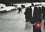 Image of Ice skating races outdoors on a flooded stadium ice rink during winter United States USA, 1900, second 62 stock footage video 65675063386
