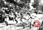 Image of Amateur runners compete in races at a stadium in the United States United States USA, 1900, second 3 stock footage video 65675063387