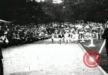 Image of Amateur runners compete in races at a stadium in the United States United States USA, 1900, second 5 stock footage video 65675063387