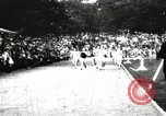 Image of Amateur runners compete in races at a stadium in the United States United States USA, 1900, second 6 stock footage video 65675063387