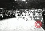 Image of Amateur runners compete in races at a stadium in the United States United States USA, 1900, second 7 stock footage video 65675063387
