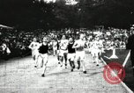 Image of Amateur runners compete in races at a stadium in the United States United States USA, 1900, second 8 stock footage video 65675063387