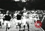Image of Amateur runners compete in races at a stadium in the United States United States USA, 1900, second 9 stock footage video 65675063387