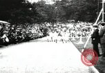 Image of Amateur runners compete in races at a stadium in the United States United States USA, 1900, second 12 stock footage video 65675063387