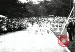 Image of Amateur runners compete in races at a stadium in the United States United States USA, 1900, second 13 stock footage video 65675063387