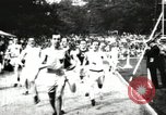 Image of Amateur runners compete in races at a stadium in the United States United States USA, 1900, second 15 stock footage video 65675063387
