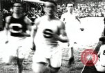 Image of Amateur runners compete in races at a stadium in the United States United States USA, 1900, second 21 stock footage video 65675063387
