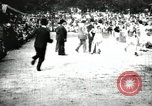 Image of Amateur runners compete in races at a stadium in the United States United States USA, 1900, second 30 stock footage video 65675063387