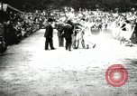Image of Amateur runners compete in races at a stadium in the United States United States USA, 1900, second 31 stock footage video 65675063387