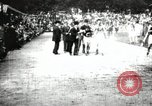 Image of Amateur runners compete in races at a stadium in the United States United States USA, 1900, second 32 stock footage video 65675063387