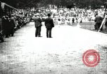 Image of Amateur runners compete in races at a stadium in the United States United States USA, 1900, second 34 stock footage video 65675063387
