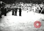 Image of Amateur runners compete in races at a stadium in the United States United States USA, 1900, second 38 stock footage video 65675063387