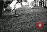 Image of Amateur runners compete in steeplechase race with obstacles United States USA, 1900, second 8 stock footage video 65675063388