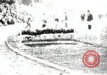 Image of Amateur runners compete in steeplechase race with obstacles United States USA, 1900, second 11 stock footage video 65675063388