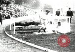 Image of Amateur runners compete in steeplechase race with obstacles United States USA, 1900, second 14 stock footage video 65675063388