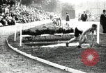 Image of Amateur runners compete in steeplechase race with obstacles United States USA, 1900, second 15 stock footage video 65675063388