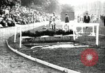 Image of Amateur runners compete in steeplechase race with obstacles United States USA, 1900, second 16 stock footage video 65675063388