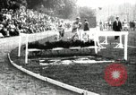 Image of Amateur runners compete in steeplechase race with obstacles United States USA, 1900, second 17 stock footage video 65675063388